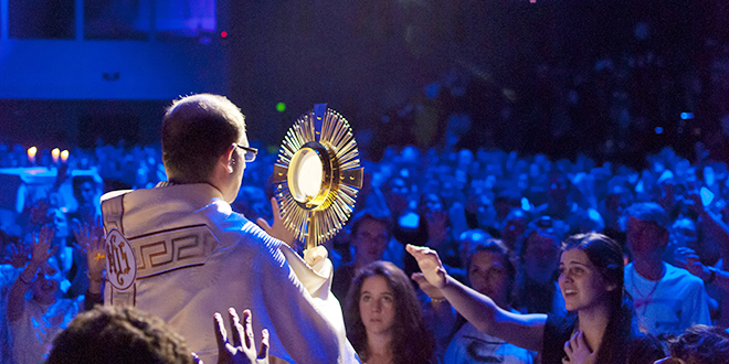 Adoring: Monsignor Anthony Randazzo during benediction at the  Ignite Conference 2013.