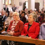 Josephite Sisters Denise Brosnan, Annette Arnold, and Margaret Gillespie honour their Order's founder and Australia's first Saint
