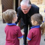 Archbishop Mark Coleridge chats to some students from Our Lady of Fatima Primary School