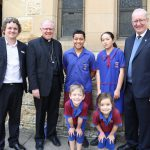 Our Lady of Fatima primary school principal Warren Fields, Archbishop Mark Colerige and students Sebasten Mikaele, Texas Parminter, Shania Parrish, Emma Maguire and Sunnybank parish priest Fr Dan Ryan