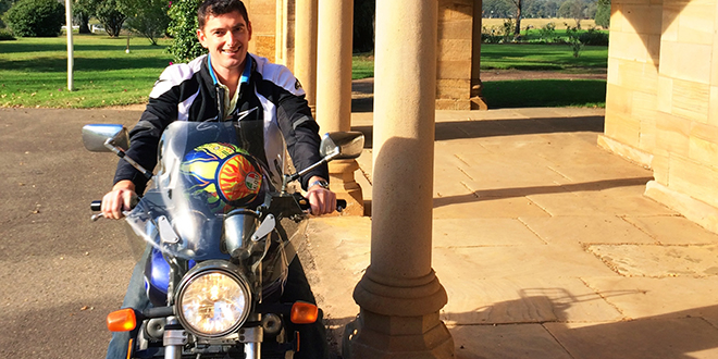 Pilgrim on wheels: Missionaries of the Sacred Heart Father Patrick Mara, on the motorbike given to him by a fellow MSC, about to head off on pilgrimage.