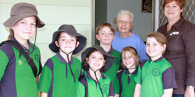 Reaching out: Assistant principal for religious education Jenny Cran with students of St Patrick's Primary School, Nanango, (from left) Charlotte Piper, Ben Vine, Yolanda Eaves, Josh Vine, Indiana Holzberger and Lotus Holzberger with a resident of Shamrock Court.