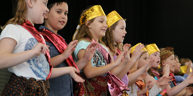 Young singers: Children from Mother Teresa primary school in Ormeau and St Joseph's Tobruk Memorial school sang two Indonesian numbers at the multicultural celebrations show. Photo: Emilie Ng