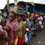 Liberians wait for food