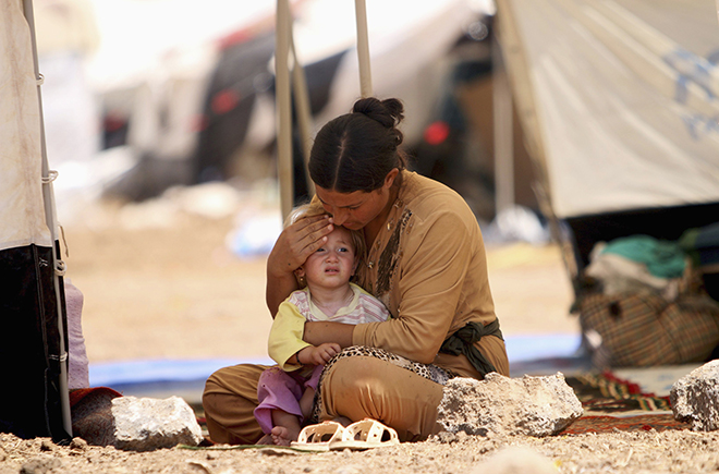 Refugee woman and child