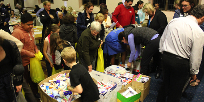 Digging deep: Families assemble the bags at the Lutwyche Parish Micah Night.