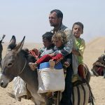 A man and three children in Iraq
