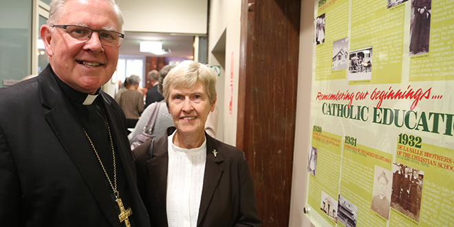 History check: Archbishop Mark Coleridge and Franciscan Sister Pauline Robinson inspect the historical display in the Queensland Catholic Education Commission offices in Brisbane.