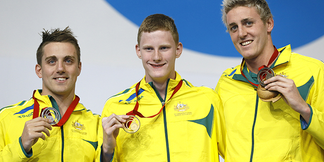 Golden effort: Australia's Matthew Cowdrey (left) with the silver, Rowan Crothers (centre) with the gold, and Brendon Hall with the bronze during the medal ceremony for the men's Para-Sport 100m freestyle S9 at the Commonwealth Games 2014 in Glasgow, Scotland. Photo: AAP