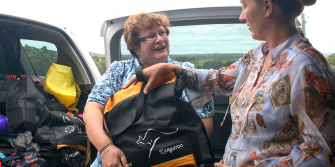 Practical ministry: A rural resident receives help from Downs & West Community Support.