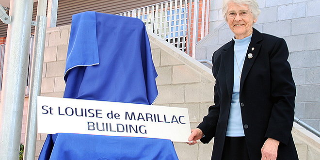 Faith honoured: Daughters of Charity representative Sr Marie Cantwell unveils a plaque to St Louise de Marillac at Seton College.