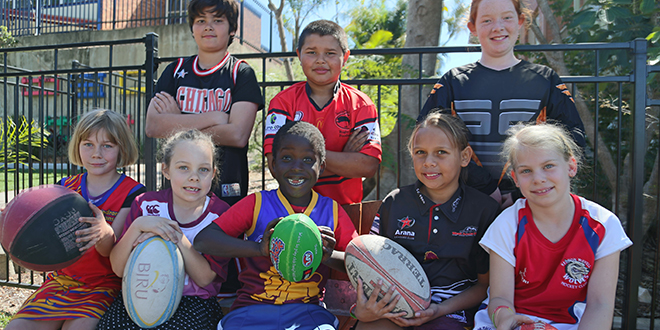 Special memories: Lily Crawford, Asha Sippel, John Gracio, Dominic Deng, Harley Mathieson, Cheyanne Pickering, Eliza Harby and Mia Cameron show their colours to support cancer sufferers.