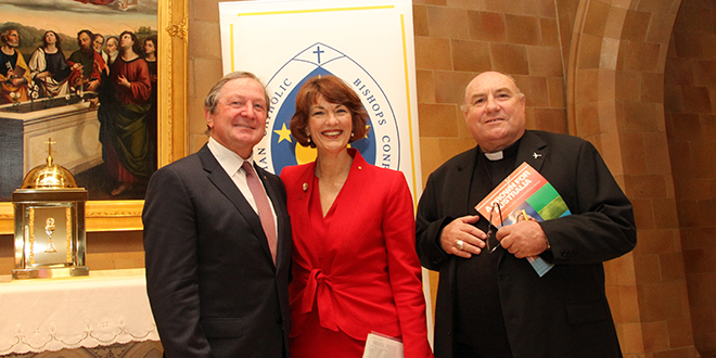 Good sports: At the launch of the Australian Catholic bishops' 2014-2015 Social Justice Statement are, from left, Kevin Sheedy, Geraldine Doogue and Bishop Christopher Saunders. Photo: The Catholic Weekly