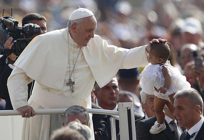 Pope Francis greets child