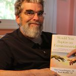 Worship through wonder: Jesuit Brother Guy Consolmagno with his new book shedding light on some of the strange places where religion and science meet. Photo: Paul Dobbyn