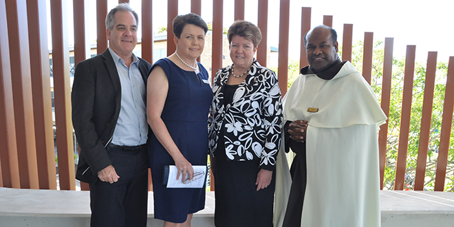 New chapter: Loreto College deputy principal religious education Kieran Donnelly, Loreto Council chair Diane Bukowski, Loreto Province Leader Sr Margaret Mary Flynn and parish priest Father Paul Sireh at the opening and blessing of Cruci.