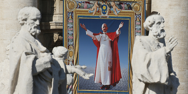Blessed pope: A tapestry of Blessed Paul VI hangs from the facade of St Peter's Basilica during his beatification Mass celebrated by Pope Francis in St. Peter's Square on October 19. Photo: CNS/Paul Haring