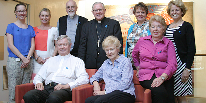 Show of support:  Brisbane Archbishop Mark Coleridge, Bishops Joseph Oudeman and Brian V. Finnigan, and executive and administration staff from the Episcopal Offices all sported coloured pins in support of Blue Knot Day.