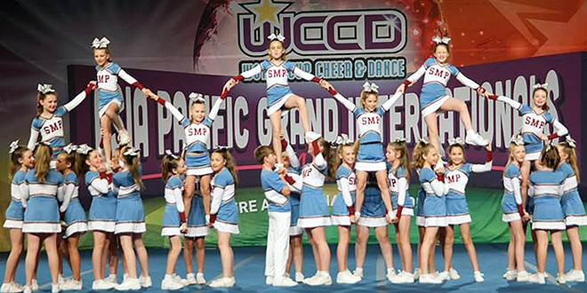 On a high: St Mary's SMP Blaze form pyramids as part of their winning performance at the WCCD Cheerleading Schools Nationals Competition