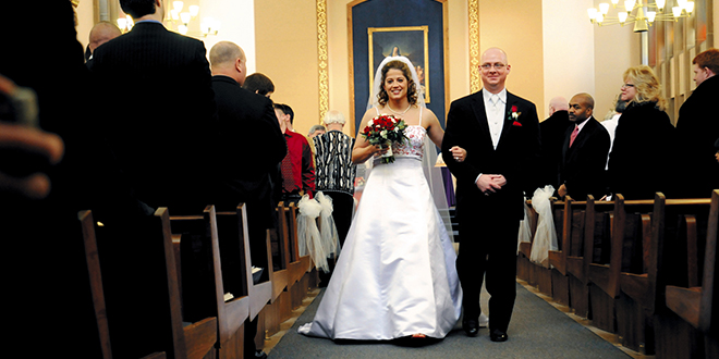 """Sharing the load: """"Deacons can preside at baptisms, weddings and funerals and may be able to assist priests in large and busy parishes by sharing some of the load and freeing the priest up for other pastoral and administrative work associated with leading a parish."""" Photo: CNS/Mike Crupi, Catholic Courier"""