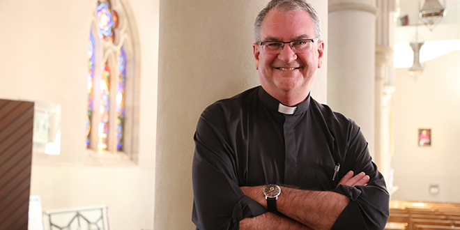 """Fr David Pascoe: """"What I love about being a priest is leading people in prayer""""."""