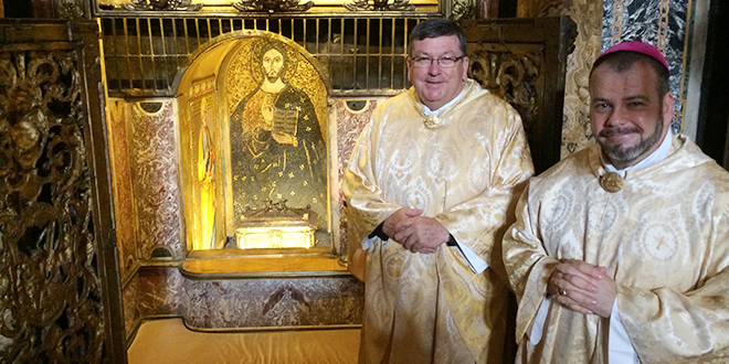 Graced moment: Bishops Michael McCarthy, left, and Columba Macbeth-Green at the Tomb of St Peter during their recent visit to Rome to attend the school for new bishops.