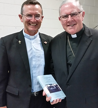Life of service: Deacon Gary Stone with Archbishop Mark Coleridge at the launch of Duntroon to Dili.