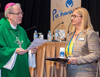 Leading the way: Suzanne Greenwood is commissioned by Bishop Donald Sproxton to lead Catholic Health Australia.