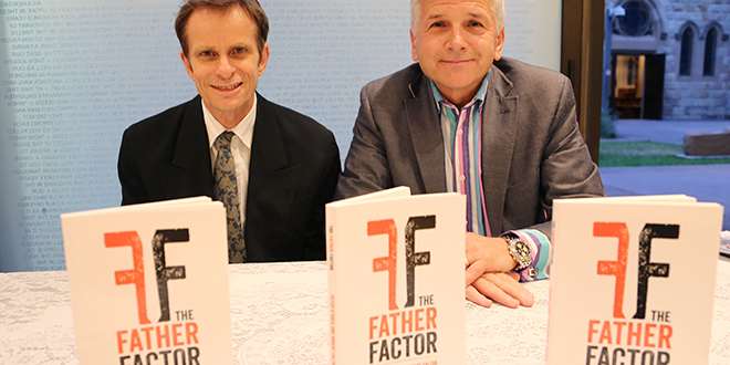 Urgent call: Co-authors of The Father Factor Peter O'Shea, left, and Robert Falzon at the launch of their new book in Brisbane's Francis Rush Centre.