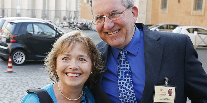 NFP blessing: Alice and Jeff Heinzen pose for a photo as they arrive for a session of the Synod of Bishops. The couple are auditors at the synod. Photo: CNS/Paul Haring