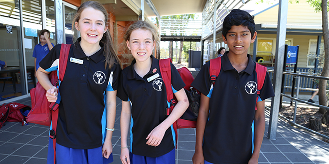 High school step: Our Lady of Dolours' Year 7 student Genevieve Ryan, Year 6 students Claire Schmeider and Allan John will make history as the first 20,000 Catholic students to start high school next year.