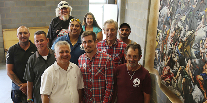 Real treasure: Men and women have turned their lives around thanks to members of Catholic outreach Blind Eye Ministries, led by Roby Curtis (front centre) and chaplain Fr Tony Girvan (front left).