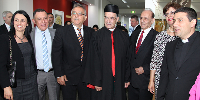Welcome guest: Patriarch Cardinal Mar Bechara Boutros Rai is greeted at Brisbane Airport by supporters including St Maroun's parish priest Fr Fadi Salame (right) during his visit to Brisbane on November 6.