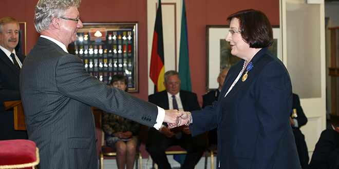 Dedication recognised: Susan Rix receives the Order of Australia Medal from dormer Queensland Governor Paul de Jersey at Government House.