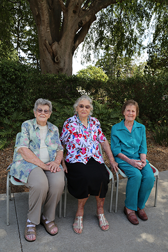 Prayer leaders: Pat Dunne, Eileen Curtin and Peg Nolan met recently to reminisce and talk about the early days and some of the highlights of the years since Petrie Parish was founded. Photo: Peter Bugden.