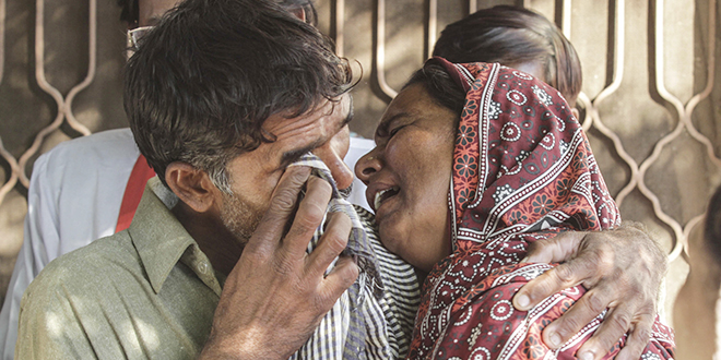 Indian murders: Relatives of a Christian couple killed after being accused of blasphemy cry at their home in Kasur, Pakistan. Catholic leaders in Pakistan protested the beating to death and burning of Shahzad Masih, 28, and his pregnant wife Shama Bibi, 24, who were accused of desecrating the Quran. Photo: CNS