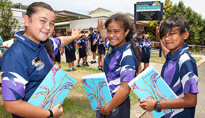 End of an era: Year 6 students at Christ the King Catholic Primary School, Deception Bay, (from left) Lian Pitt and Maria Tevaga, and Year 7 student Jolo Gapusam farewell primary school as they head to secondary school in 2015.