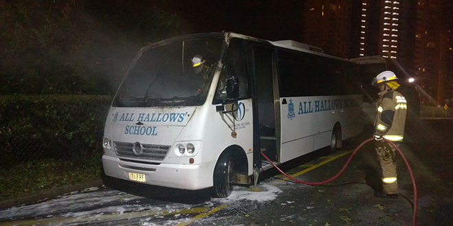 Firefighters put out the blaze that damaged an All Hallows' School bus on November 27