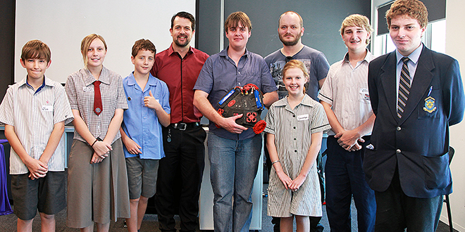 Robotics School Cross Collaboration Day organiser Jay Hobbs and guest speakers Karl Von Richter and Samual Ashcroft with students and their unique robot