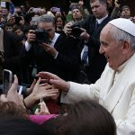 Pope Francis greets children