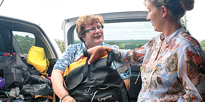 Gift of giving: Tracy receiving some household items from Sister of Charity Christine Henry.