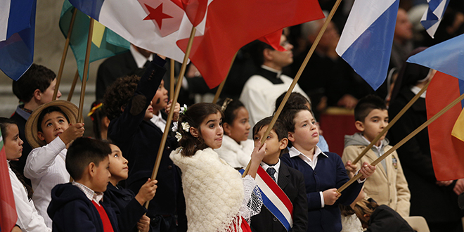 Great mission: Children carry flags of nations during a Mass marking the feast of Our Lady of Guadalupe in St Peter's Basilica on December 12. Photo: CNS/Paul Haring