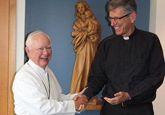 Shared congratulations: Oblate Father Lewy Keelty (left) congratulates his Oblate brother Bishop-elect Mark Edwards on his appointment as an auxiliary bishop of Melbourne and Bishop-elect Edwards congratulates his community superior Fr Keelty on 50 years of priesthood.