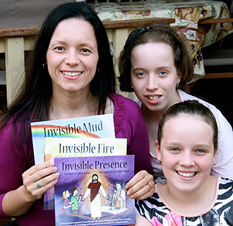 Newly released: Author and columnist Selina Venier with her new book, Invisible Presence, and daughters Gabriella and Alessia.