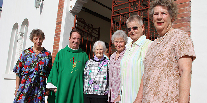 Mission field: Monsignor Peter Meneely and parishioners from St Luke's Church, Buranda.