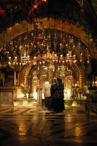 Prayerful: Pilgrims lighting candles in the Church of the Holy Sepulchre. Photos: CNS