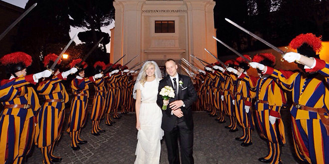 Vatican City wedding: Newlyweds Joanne and Corporal Dominic Bergamin walk through a Swiss Guard of honour after their wedding Mass.  Photo: Katarzyna Artymiak