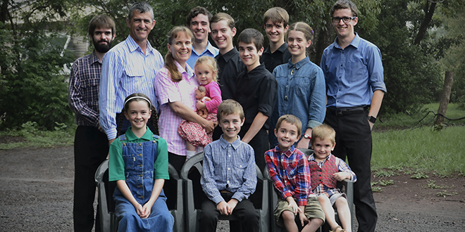 Musical family: Toowoomba's Webb family members, from back left, David, dad Paul and mum Fiona, holding Brigid, Nathan, Peter, James, Isaac, Nancy, Liam, and from front left, Rebecca, Thomas, Owen and Xavier.