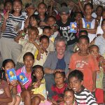 Practical help: Chris Ng with members of a community in East Timor.