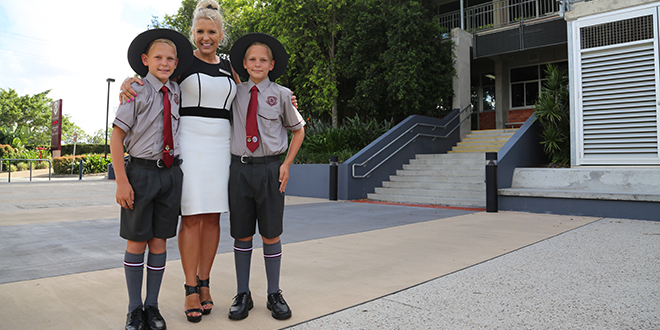 Making history: Mum and Clairvaux MacKillop College teacher Tanya Ford with her twin sons Izak and Mason as they embark on their first day of Year 7.